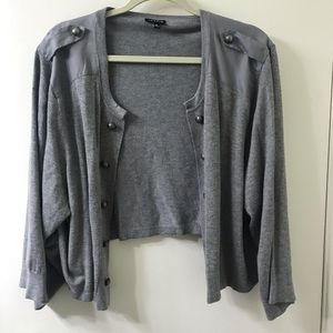 Grey knit shrug with decorative buttons